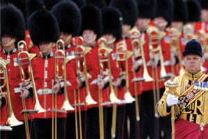 The Band of the Royal Marines and The Pipes, Drums, and HIghland Dancers of the Scots Guards