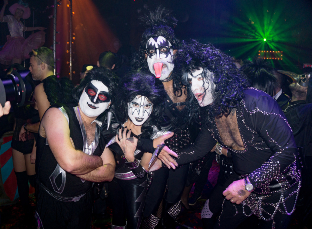 <p>What Halloween bash is complete without partygoers costumed like the rock band KISS?</p><br />(© Seth Walters)