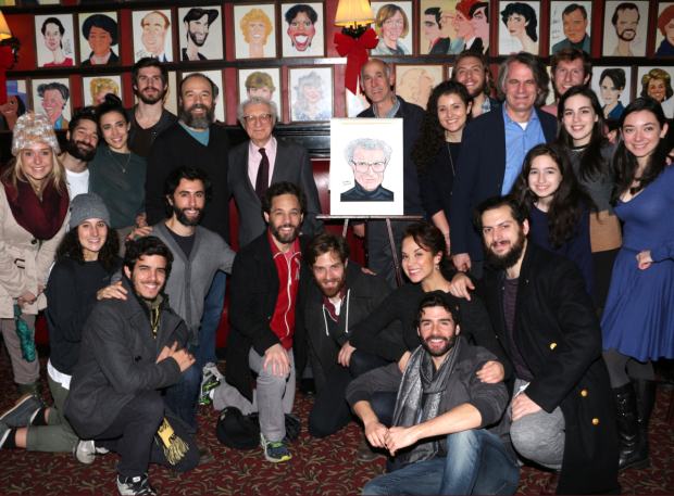 <p>Team <em>Fiddler on the Roof</em> takes a snapshot with Harnick and his caricature.</p><br />(© David Gordon)
