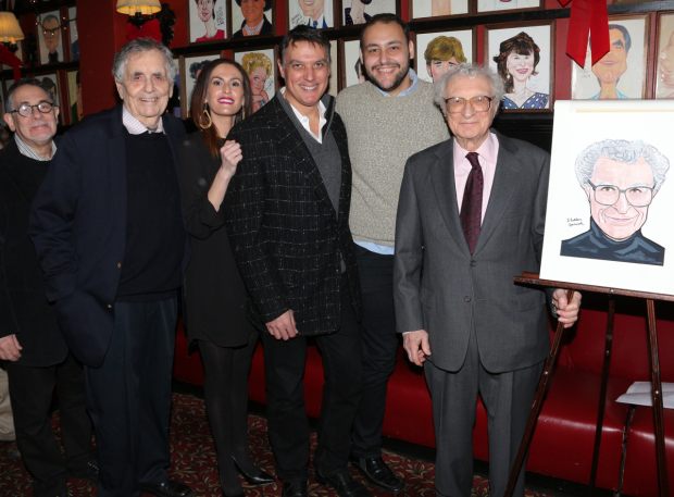 <p>The team behind <em>Rothschild &amp&#x3B; Sons</em> poses with Harnick and his caricature.</p><br />(© David Gordon)