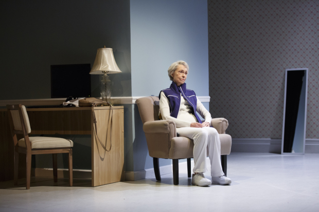 <p>Deanna Dunagan sits alone with her thoughts.</p><br />(© Joan Marcus)