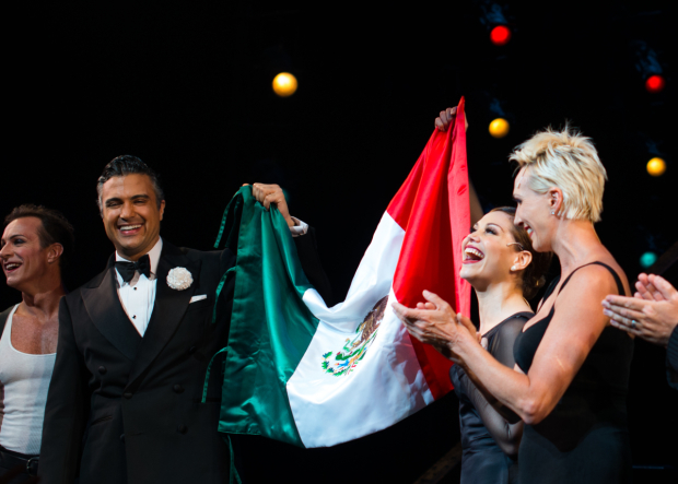 <p>Camil and Marroquín hold up the Mexican flag to celebrate the accomplishment.</p><br />(© Allison Stock)