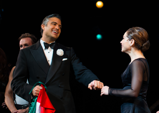 <p>Camil greets returning cast member Bianca Marroquín, who takes on the role of Roxie Hart.</p><br />(© Allison Stock)