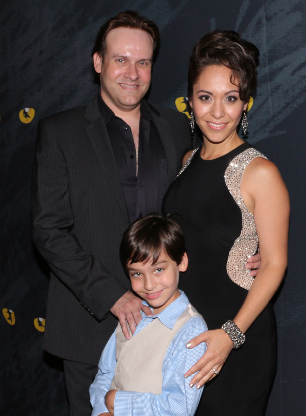 <p><em>Cats</em> chorus member Richard Todd Adams is joined by his family, Maria Eberline and their son Nate Adams, on the red carpet.</p><br />(© David Gordon)