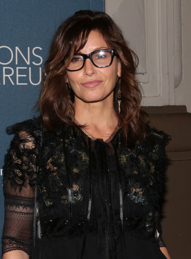 <p>Gina Gershon takes a photo at the opening of <em>Les Liaisons Dangereuses</em>.</p><br />(© David Gordon)