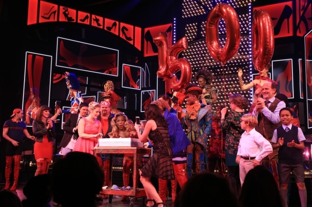 <p>Todrick Hall poses with the special anniversary cake.</p><br />(© Tricia Baron)