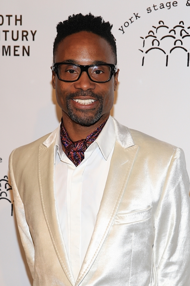 <p>Billy Porter takes a photo as he arrives.</p><br />(© Tricia Baron)