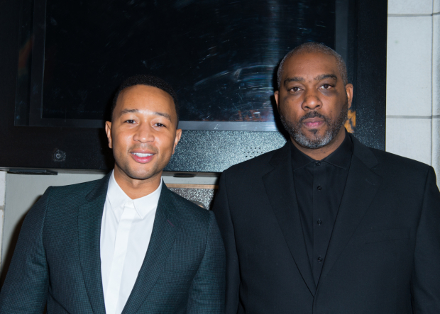 <p><em>Jitney</em> producers John Legend and Mike Jackson toast their opening night.</p><br />(© Allison Stock)