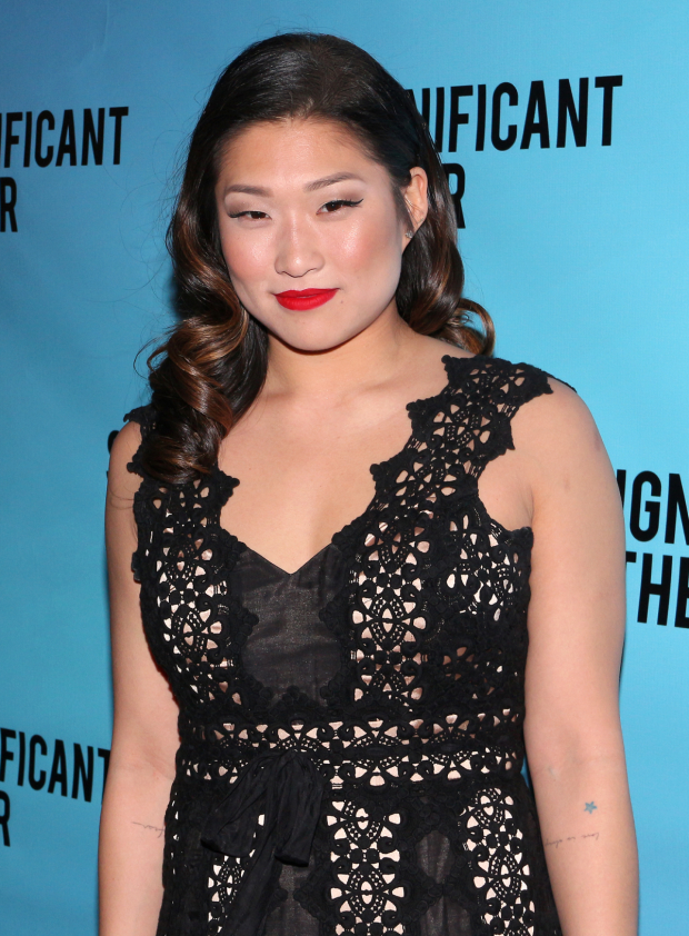 <p>Jenna Ushkowitz heads into the Booth Theatre.</p><br />(© David Gordon)
