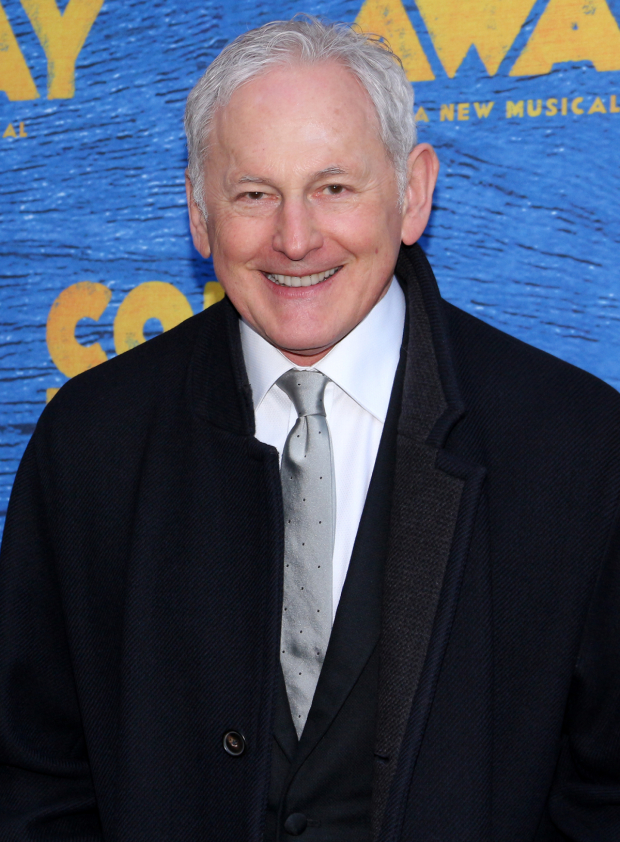 <p>Victor Garber smiles for the cameras before the show.</p><br />(© David Gordon)