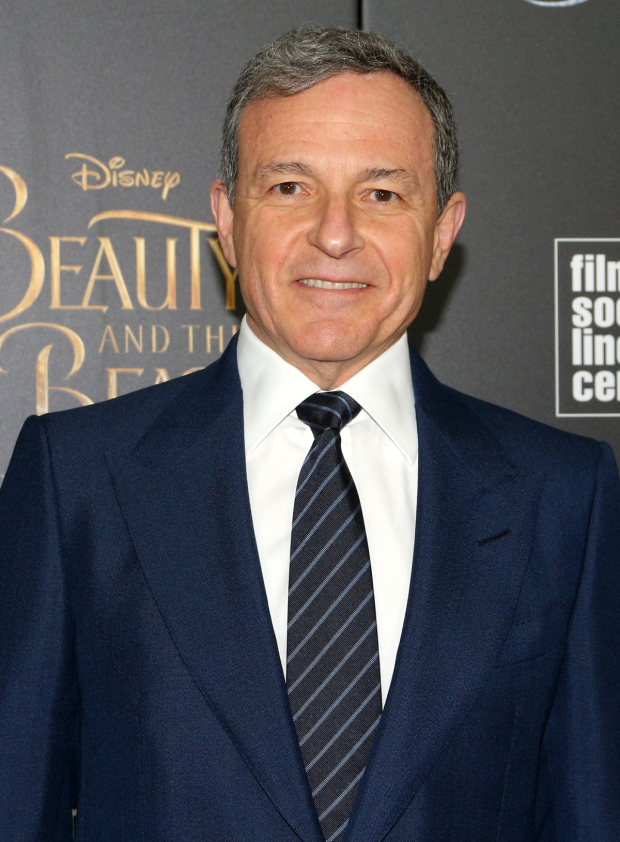 <p>Walt Disney Company CEO Bob Iger is proud to see the latest Disney film on the big screen.</p><br />(© David Gordon)