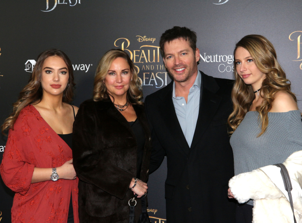 <p>Jill Goodacre, Harry Connick Jr., and their daughters walk the red carpet.</p><br />(© David Gordon)