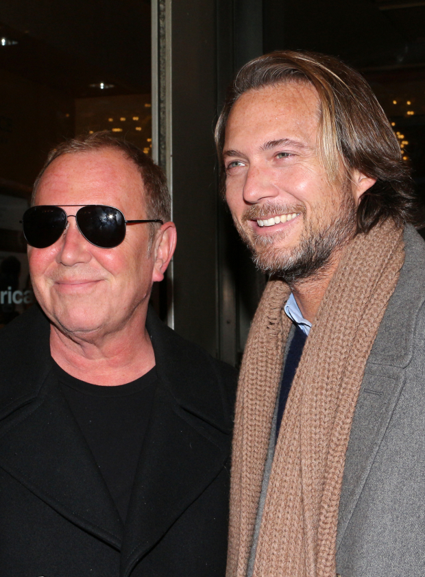 <p>Michael Kors and Lance Le Pere head into the American Airlines Theatre.</p><br />(© David Gordon)