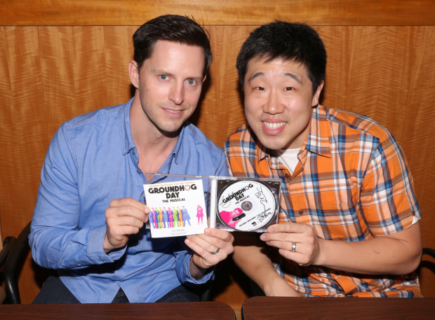 <p>Andrew Call and Raymond J. Lee hold up their signed CD.</p><br />(© David Gordon)