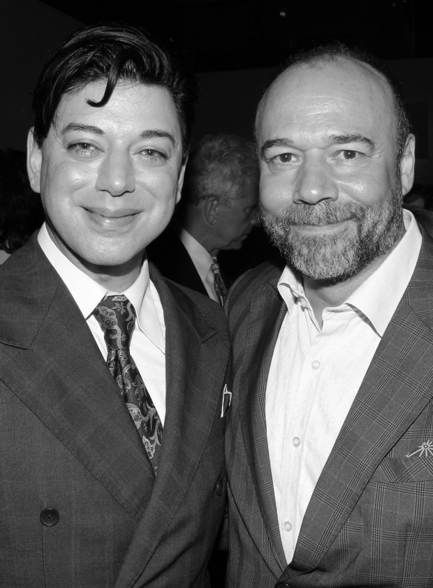 <p>Drama Desk Awards presenter Danny Burstein (right) hangs out at the after-party with his guest, fashion designer Malan Breton.</p><br />(© David Gordon)