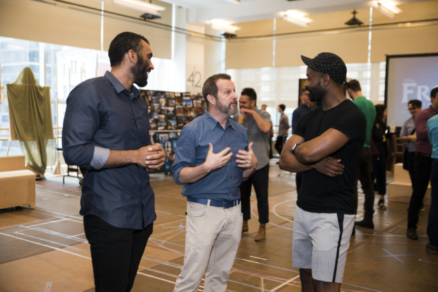 <p>Choreographer Rob Ashford (center) speaks with Travis Patton and Rob James Brown III.</p><br />(© Jenny Anderson)