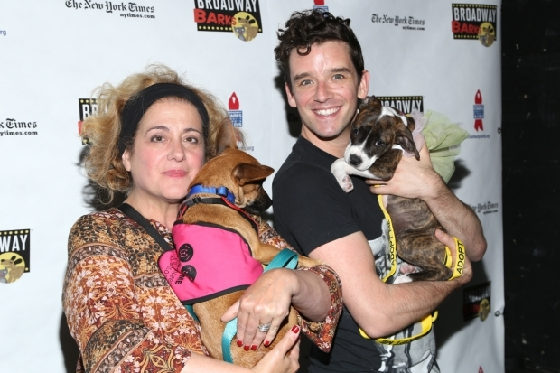 <p><em>The Government Inspector</em>&#39&#x3B;s Mary Testa and Michael Urie take a break to play with some pups.</p><br />(© Tricia Baron)