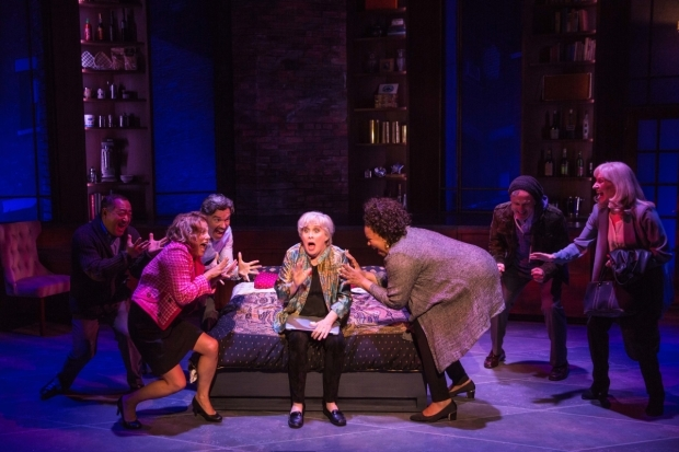 <p>A shocked Nancy Opel (center) is surrounded by her castmates.</p><br />(© Matthew Murphy)
