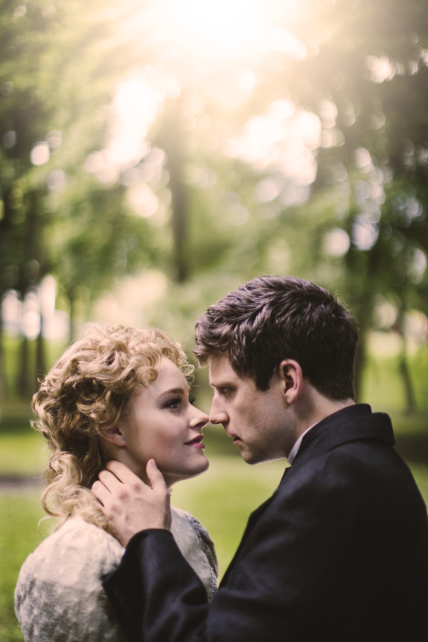 <p>Nicki Elledge and Sam Ludwig share a romantic moment bathed in sunlight.</p><br />(© Noah Chiet)