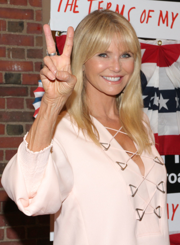 <p>Christie Brinkley flashes the peace sign.</p><br />(© David Gordon)
