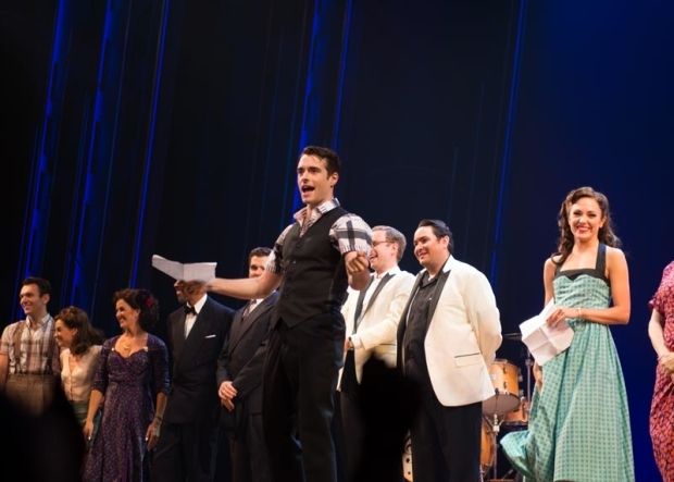 <p>Corey Cott announces their special guests to the audience.</p><br />(© Allison Stock)