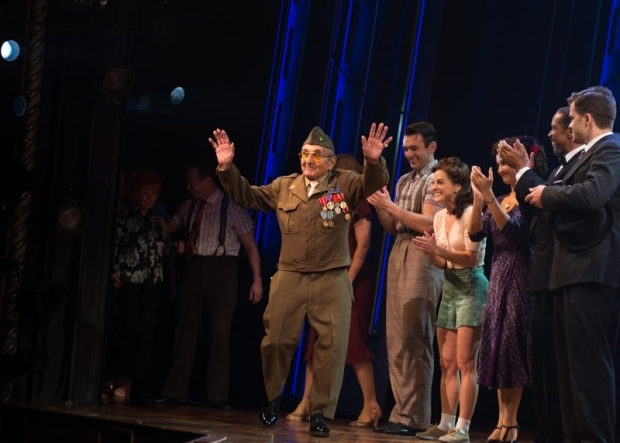<p>Purple Heart recipient Luke Gasparre is welcomed to the stage.</p><br />(© Allison Stock)