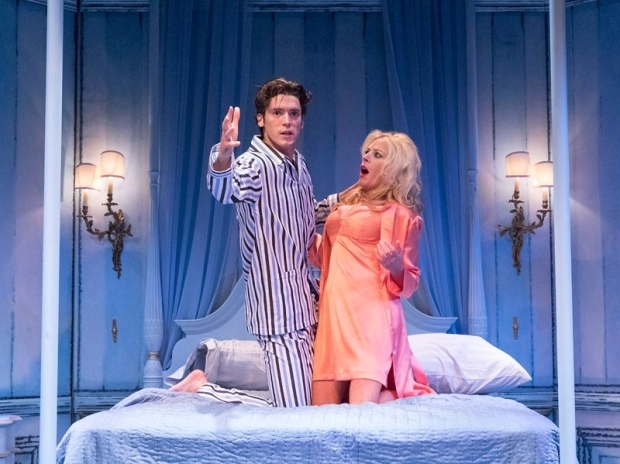 <p>Pico Alexander makes a grand gesture with Sherie Rene Scott in the bedroom.</p><br />(© Richard Termine)
