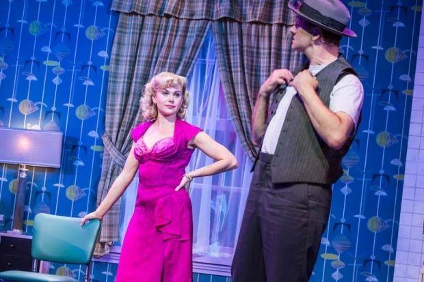 <p>Laura Bell Bundy stars as Trixie opposite Michael Mastro as Norton.</p><br />(© Evan Zimmerman)