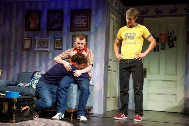 <p>Michael Urie is embraced by Jack DiFalco as Ward Horton looks on.</p><br />(© Joan Marcus)