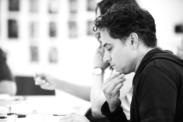 <p>Playwright Rajiv Joseph sits in on rehearsals.</p><br />(© Ahron R. Foster)