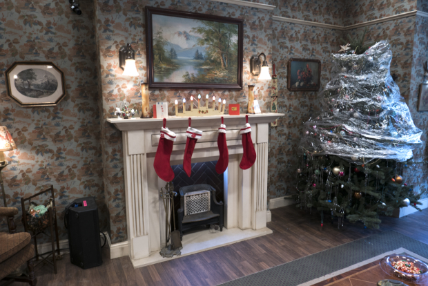 <p>Inside, a Christmas-themed living room takes shape.</p><br />(© David Gordon and Seth Walters)