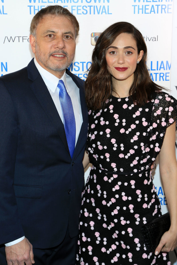 <p><em>Shameless</em> star Emmy Rossum and Gary Levine stop for a photo.</p><br />(© Tricia Baron)