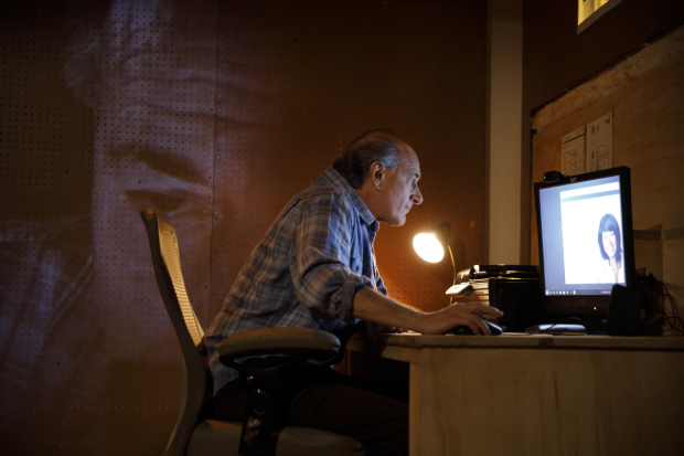 <p>Peter Friedman stays up working late.</p><br />(© Joan Marcus)
