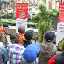 The Grinch Reads to Children to Kick Off Charity Book Drive