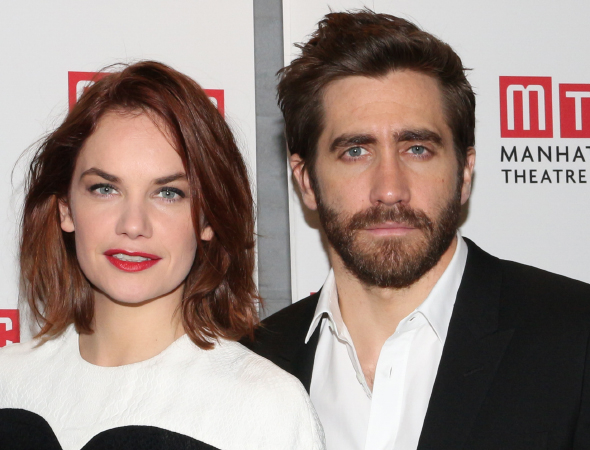 <p>Ruth Wilson and Jake Gyllenhaal pose for photos upon arriving at the <em>Constellations</em> opening-night party.</p><br />(© David Gordon)