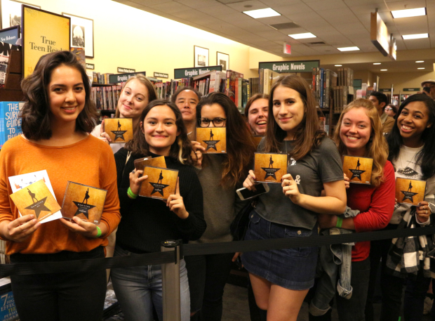 <p>A group of <em>Hamil</em>-fans  pose with their CDs.</p><br />(© David Gordon)