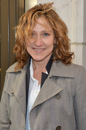 <p>A wind-blown Edie Falco heads into the Friedman Theatre.</p><br />(© David Gordon)
