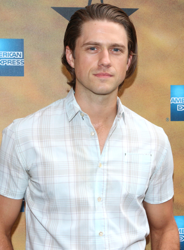 <p>Aaron Tveit, who will lead the upcoming live TV version of <em>Grease</em>, poses for photos before the opening of <em>Hamilton</em>.</p><br />(© David Gordon)