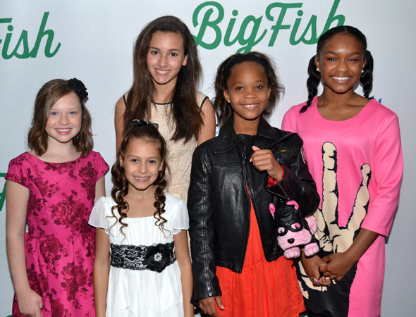 <p>Academy Award nominee Quvenzhané Wallis (second from right) pals around with her <em>Annie</em> costars on opening night.</p><br />(© David Gordon)