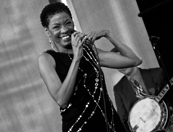 "<p>Adriane Lenox serenades the audience with ""Women Be Wise.""</p><br />(© David Gordon)"