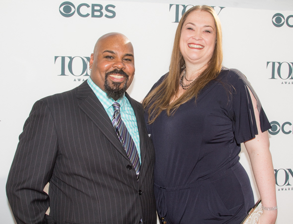 <p><em>Aladdin</em>&#39&#x3B;s James Monroe Iglehart poses on the red carpet with his wife, Dawn.</p><br />(© Seth Walters)