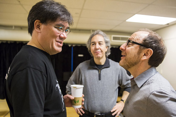 <p>Alan Gilbert and assistant conductor Grant Sturiale confer with director Lonny Price.</p><br />(© Chris Lee)