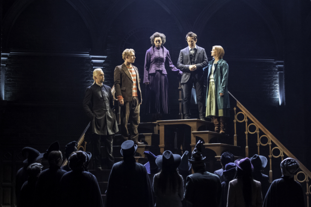 <p>Alex Price (Draco Malfoy), Paul Thornley (Ron Weasley), Noma Dumezweni (Hermione Granger), Jamie Parker (Harry Potter), and Poppy Miller (Ginny Potter) in <em>Harry Potter and the Cursed Child</em>.</p><br />(© Manuel Harlan)