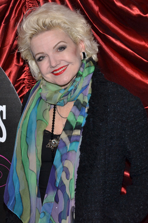 <p>Alison Fraser smiles for the cameras on her way into the Walter Kerr Theatre.</p><br />(© David Gordon)