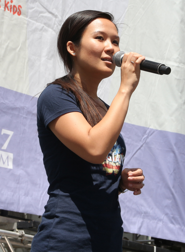 <p><em>Allegiance</em> cast member Elena Wang sings for a huge crowd on a beautiful day.</p><br />(© David Gordon)