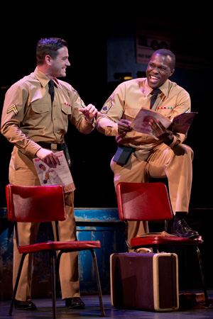 <p>Along her journey, Violet (Sutton Foster) meets Monty (Colin Donnell) and Flick (Joshua Henry), two soldiers who are also traveling across the country.</p><br />(© Joan Marcus)