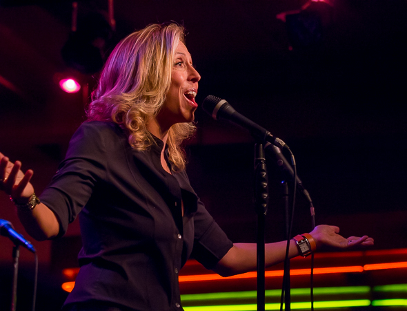 <p>Amanda Green takes the mic at Birdland.</p><br />(© Seth Walters)