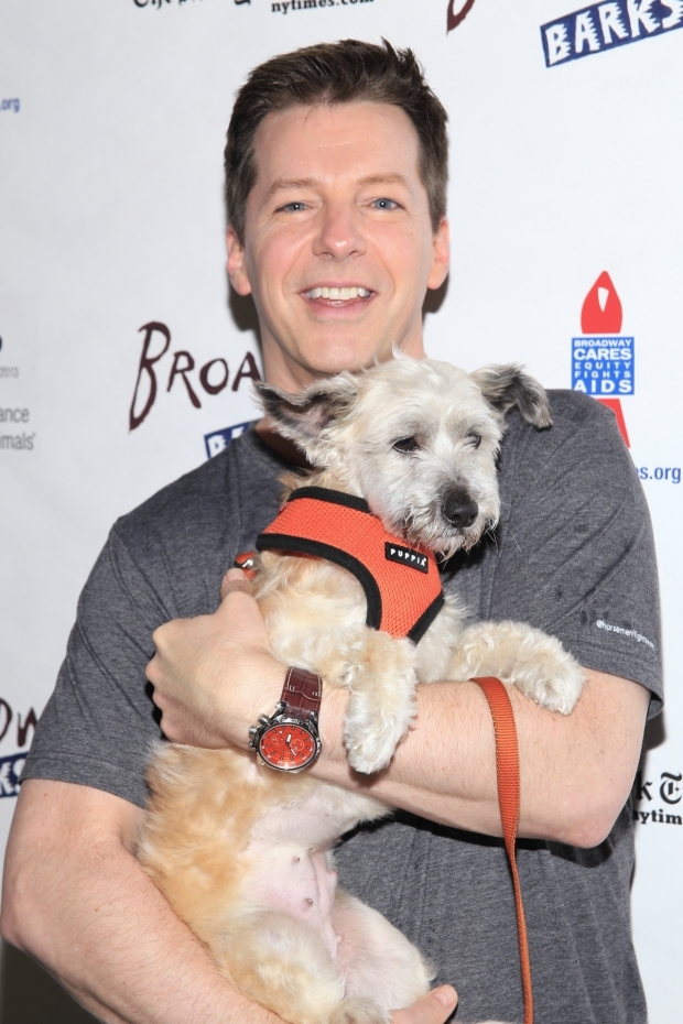 <p><em>An Act of God</em> star Sean Hayes shows off one of the many dogs that are up for adoption.</p><br />(© Tricia Baron)