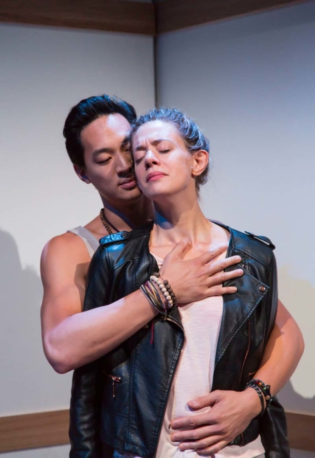 <p>An intimate moment between Edward Chin-Lyn and Brenna Palughi.</p><br />(© T. Charles Erickson)