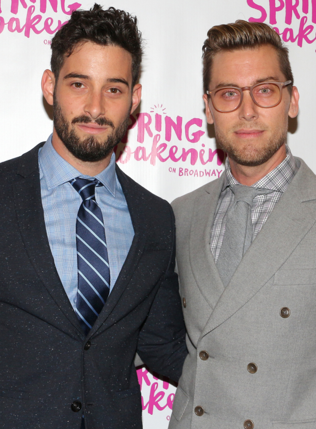 <p>NSYNC alum Lance Bass (right) takes in the show with his hubb, Michael Turchin.</p><br />(© David Gordon)